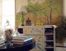 Living room with vintage library table, school map and chinoiserie lamp & painted sideboard.