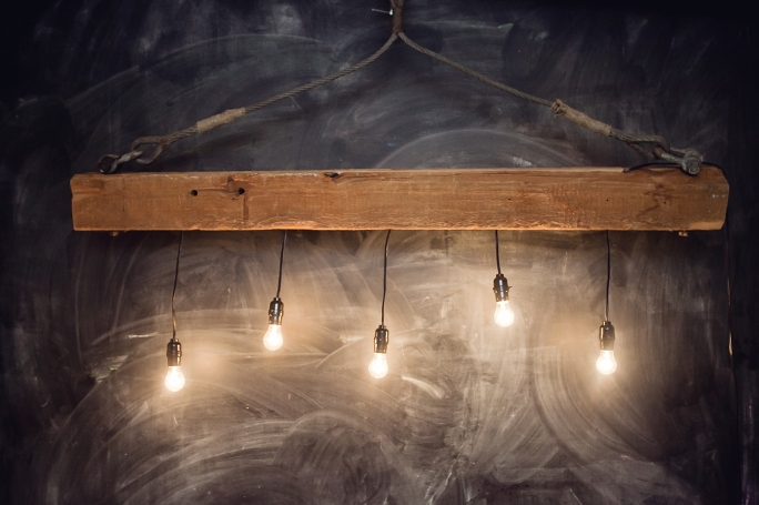 Handmade light from vintage beam and cable
