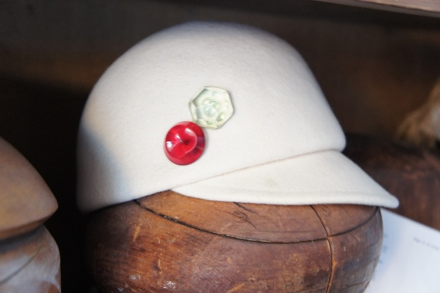 White hat with buttons
