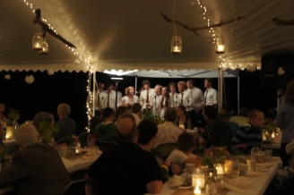 The bridal party serenades us