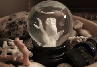 sculpted owl snow globe