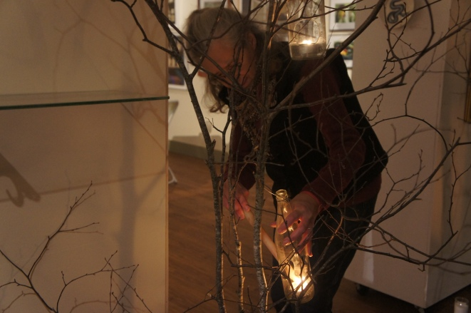AnneMarie, one of the owners of Flatrocks Gallery, lighting the candles in anticipation of the guests.