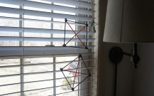 """kites"" hanging in the window."