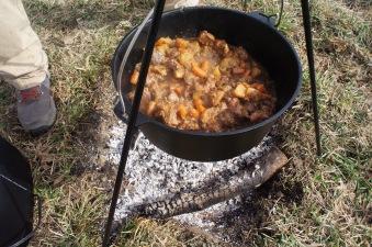 Beef stew over an open fire